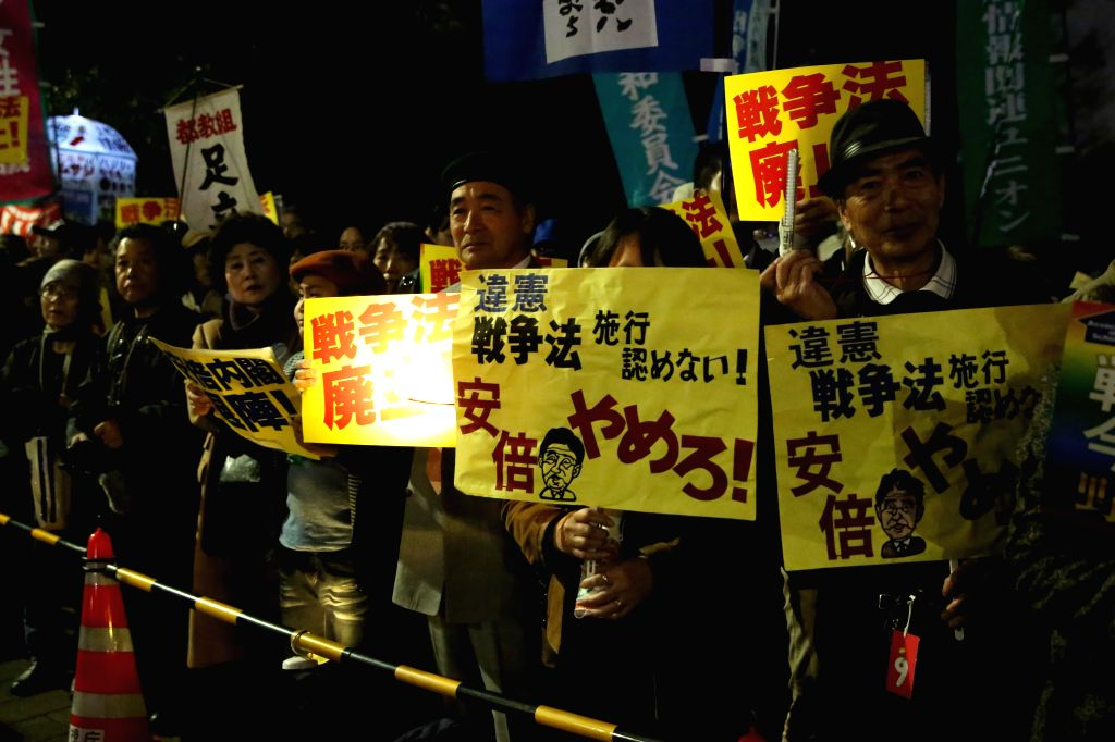 TOKYO, March 29, 2016 - Protesters hold a mass demonstration against the controversial security laws in front of the Diet building in central Tokyo, Japan, March 29, 2016. Japan's new controversial ...