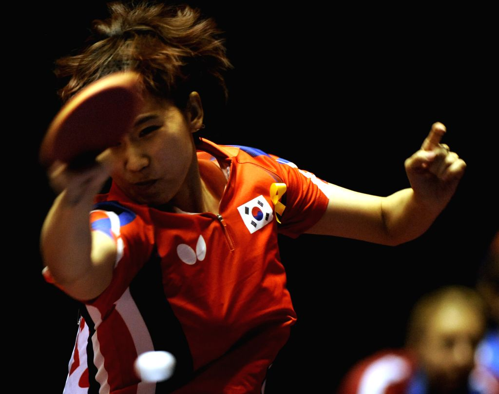 Hanjung Seok of South Korea plays against Sarah De Nutte of Luxembourg during the single's match in Zen Noh 2014 World Table Tennis Championships in Tokyo, Japan, May ..