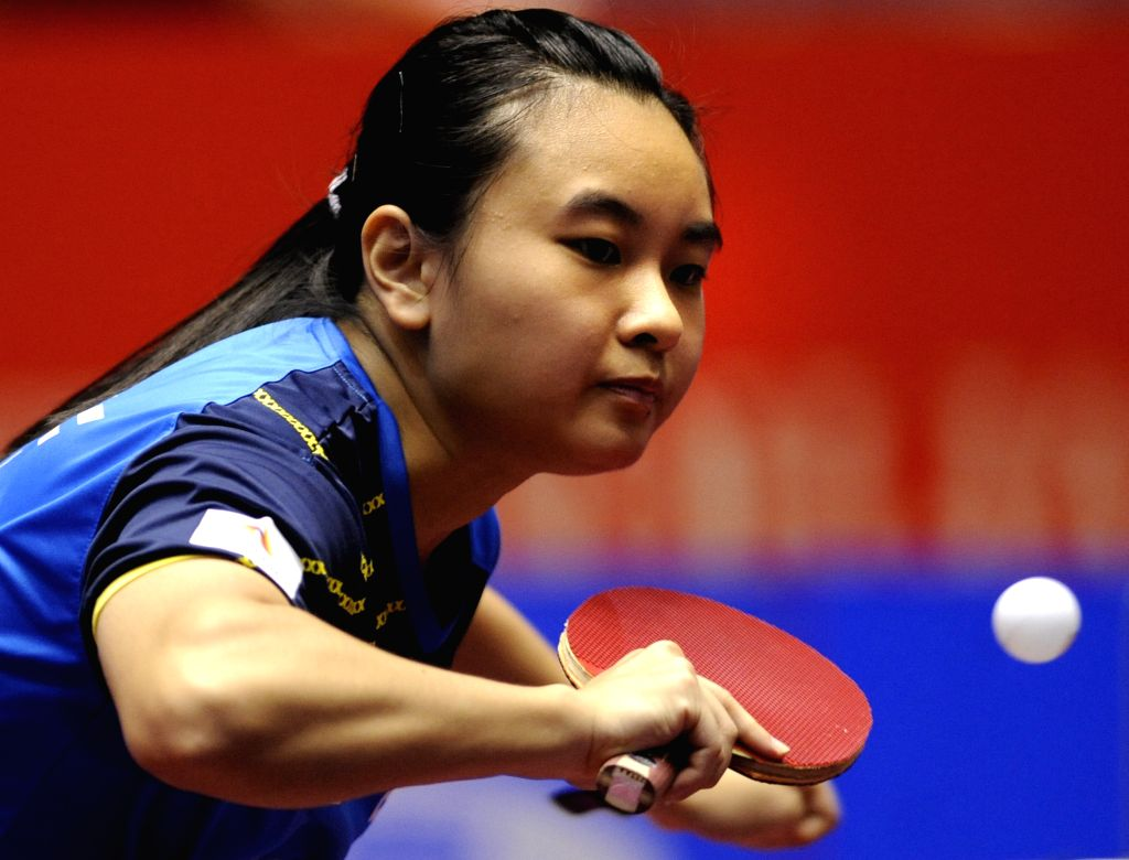 Li Isabelle Siyun of Singapore plays against Laura Gasnier of France during the single's match in Zen Noh 2014 World Table Tennis Championships in Tokyo, Japan, May 1, .