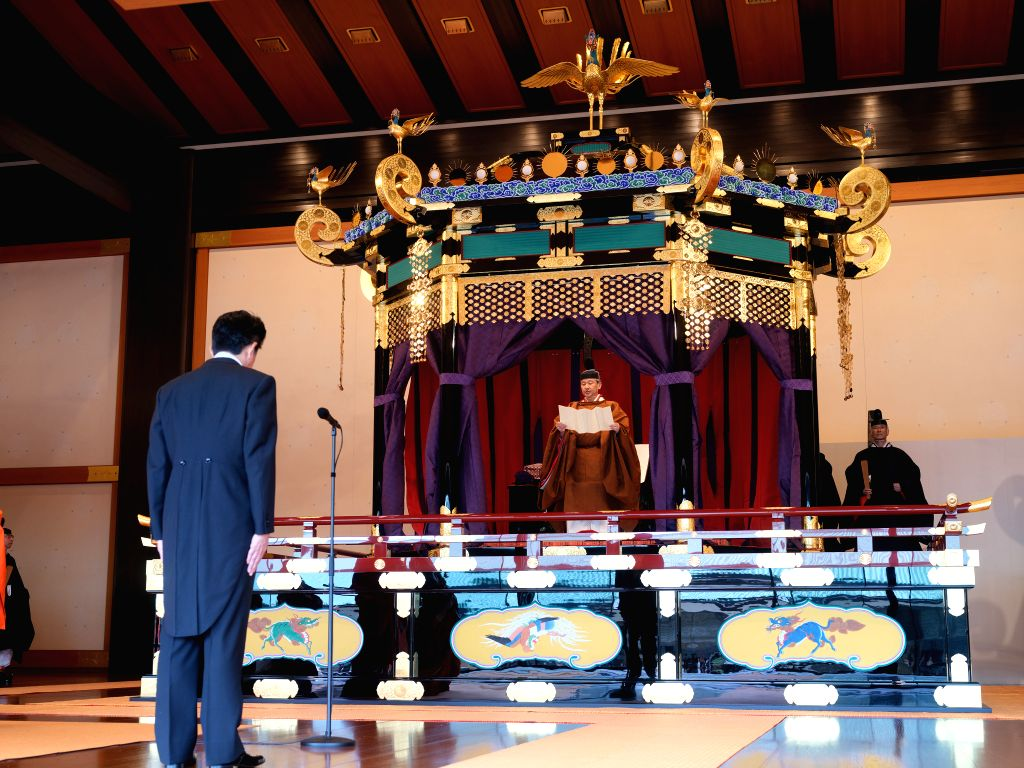 TOKYO, Oct. 22, 2019 - Japanese Emperor Naruhito (C) and Prime Minister Shinzo Abe (L) attend the emperor's coronation ceremony in the Seiden State Hall at the Imperial Palace in Tokyo, Japan, Oct. ... - Shinzo Abe
