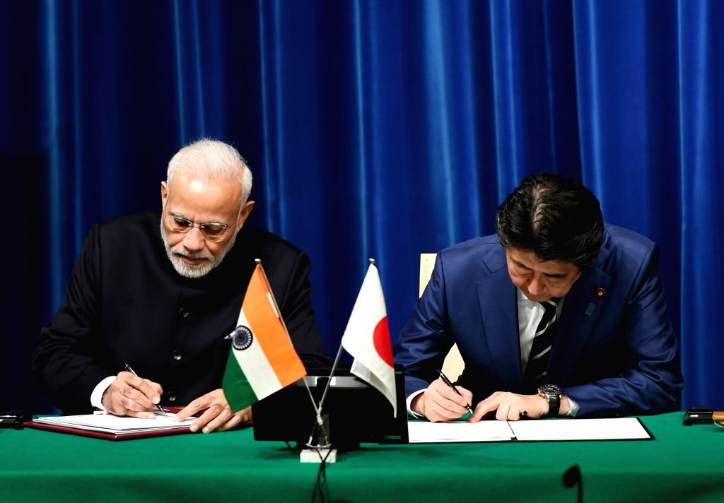 :Tokyo: Prime Minister Narendra Modi and Japanese Prime Minister Shinzo Abe at the ceremony for signing and exchange of agreements in Tokyo, Japan on Oct 29, 2018. (Photo: IANS/PIB).
