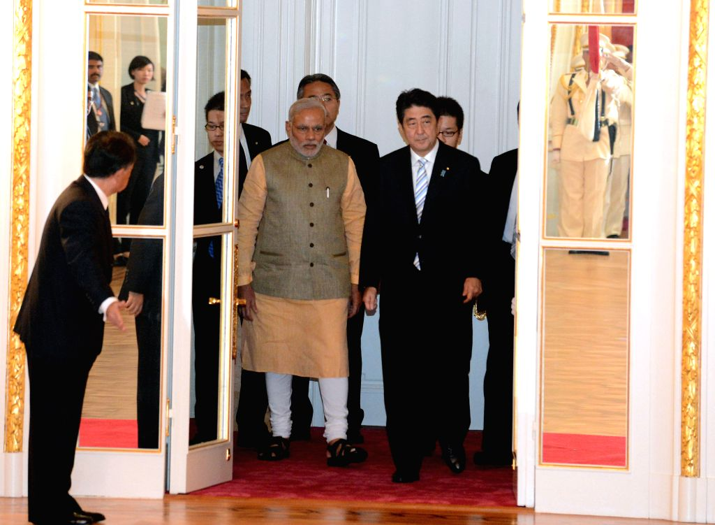 Indian Prime Minister Narendra Modi (2nd R, front ) meets with his Japanese counterpart Shinzo Abe (1st R, front) in Tokyo, Japan, on Sept. 1, 2014. Modi started a ...