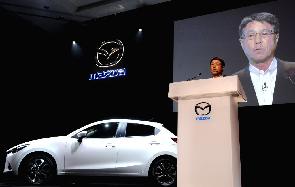 Japan's auto maker Mazda Motor President and CEO Masamichi Kogai speaks at a press conference to introduce Mazda's new model DEMIO in Tokyo, Japan, on Sept. 11, ...