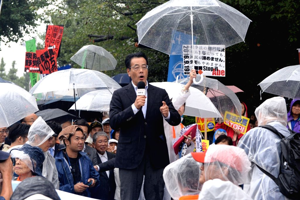 TOKYO, Sept. 19, 2016 - Former president of Japan's largest opposition Democratic Party Katsuya Okada bitterly attacks the controversial security laws during the protest rally at Tokyo, Japan, Sept. ...