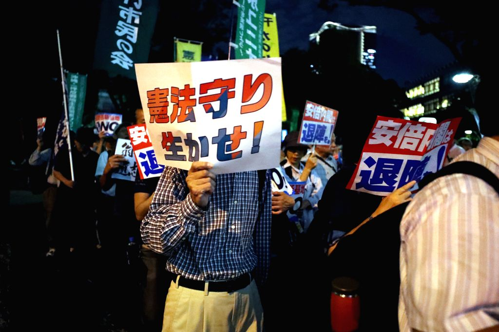 TOKYO, Sept. 19, 2018 - A protester participates in a demonstration in Tokyo, Japan, on Sept. 19, 2018. Thousands of people across Japan rallied Wednesday to protest against the controversial ...