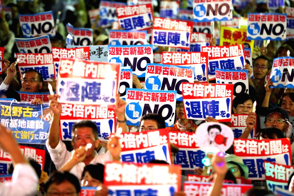 TOKYO, Sept. 19, 2018 - Protesters participate in a gathering in Tokyo, Japan, on Sept. 19, 2018. Thousands of people across Japan rallied Wednesday to protest against the controversial security laws ...