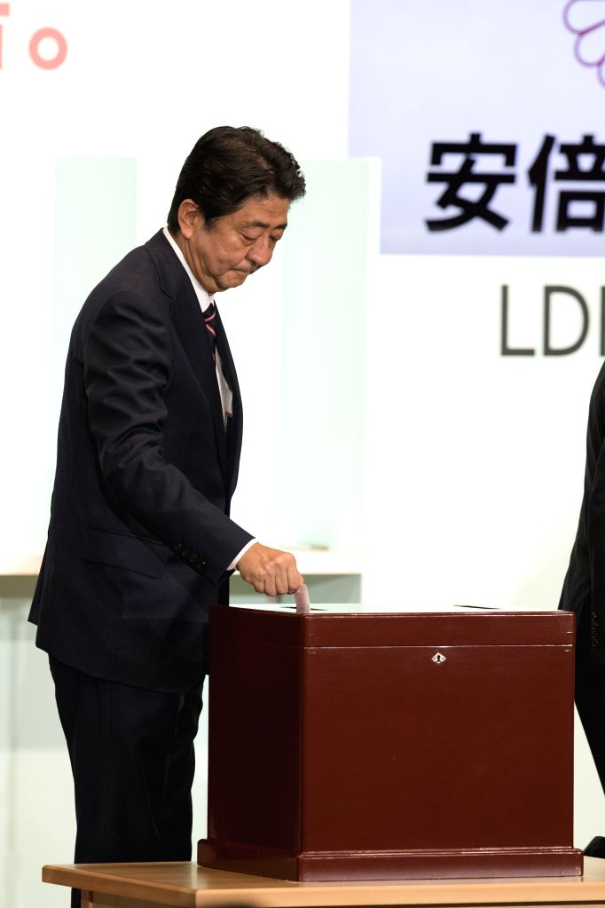 TOKYO, Sept. 20, 2018 - Japanese Prime Minister Shinzo Abe casts his vote during the ruling Liberal Democratic Party (LDP) leadership election in Tokyo, Japan, on Sept. 20, 2018. Shinzo Abe won a ... - Shinzo Abe