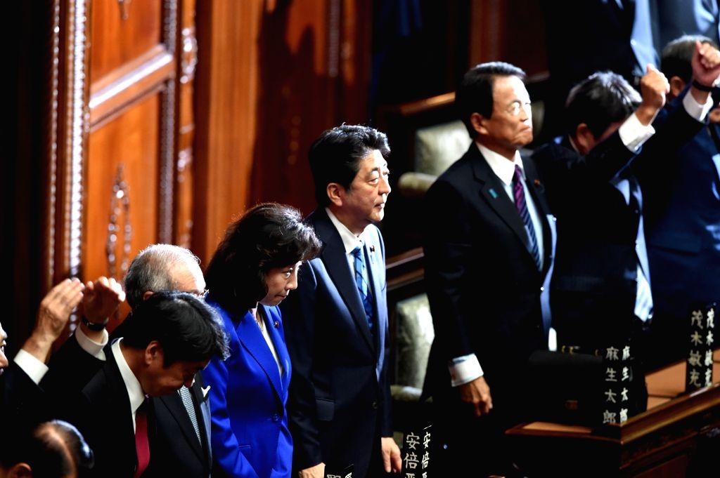 TOKYO, Sept. 28, 2017 - Japanese Prime Minister Shinzo Abe (C) listens as House of Representatives Speaker Tadamori Oshima(unseen) announces the dissolution of the lower house in Tokyo, Japan, Sept. ... - Shinzo Abe