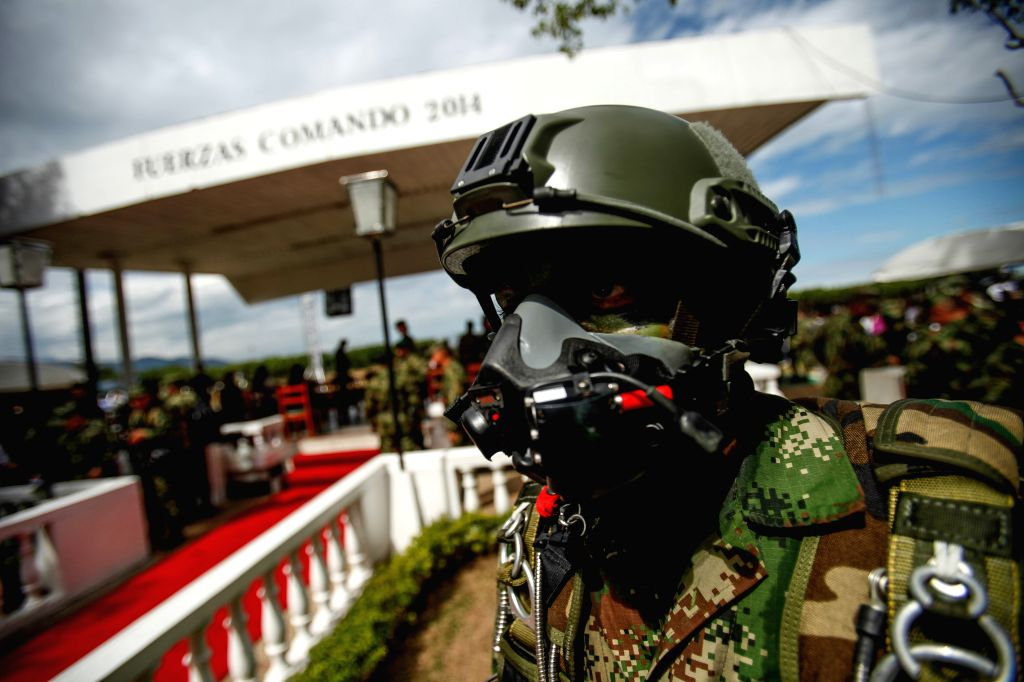 """A soldier takes part during the opening ceremony of the Military Olympic Games """"Command Forces"""" at the Military Fort of Tolemaida in Tolima department, ..."""