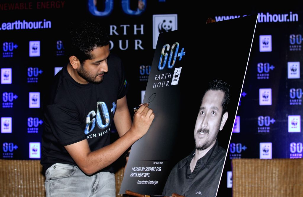 Tollywood actor Parambrata Chatterjee at an awareness campaign holding a candle light for ``Earth Hour 60`` in Kolkata on March 14, 2013. (Photo: IANS) - Parambrata Chatterjee