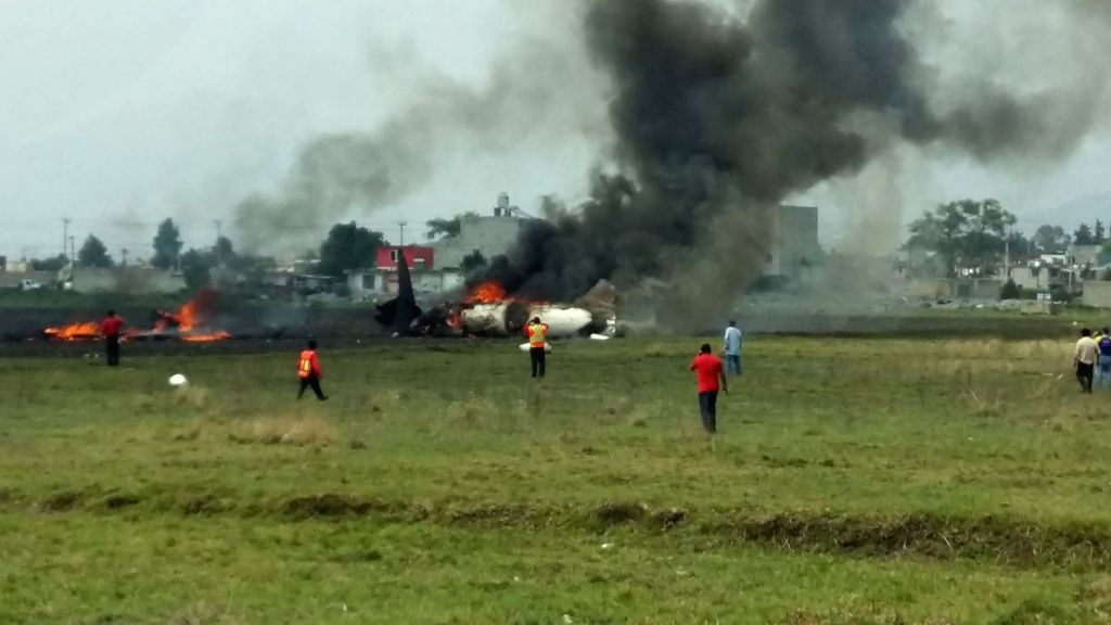TOLUCA, May 18, 2017 - Photo taken with a mobile phone shows the plane crash site near Toluca International Airport in Toluca, central Mexico, May 17, 2017. A small private aircraft crashed on ...