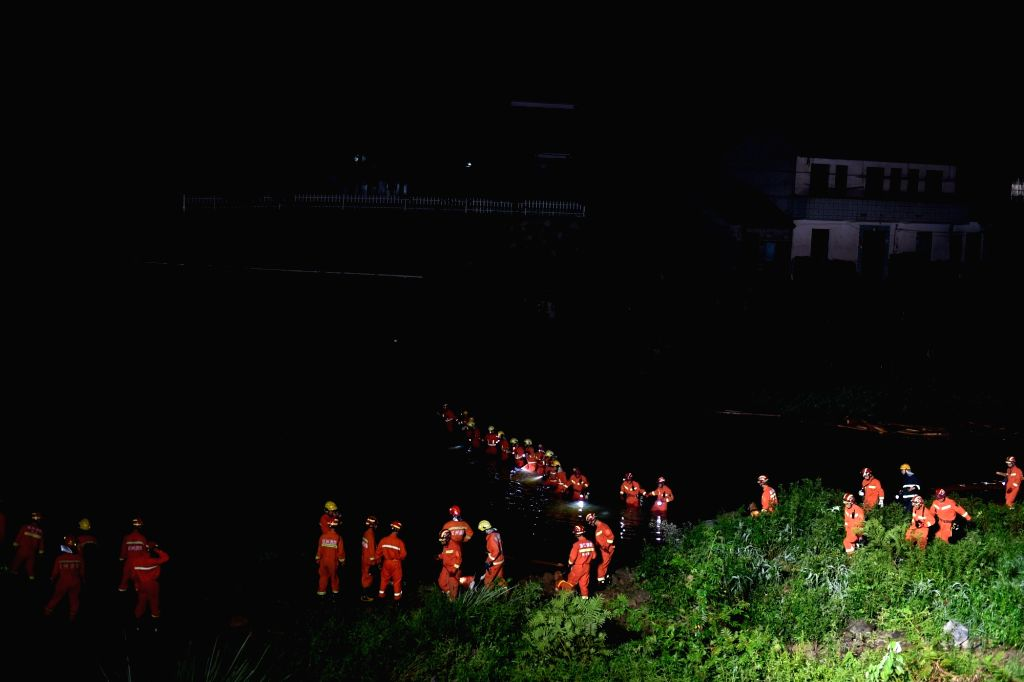TONGLU, July 28, 2018 - Rescuers work at the accident site in Tonglu County, Hangzhou City, east China's Zhejiang Province, July 28, 2018. Eight people were confirmed dead and three others injured ...