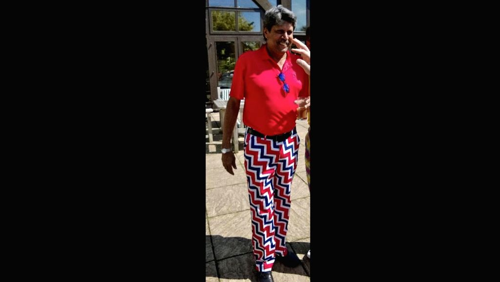 Too much of Ranveer Singh has rubbed off on Kapil Dev, you would think looking at a photograph of the iconic cricketer doing the rounds on the Internet, where he is seen sporting a gaudy red T-shirt with pants that have wild, multi-coloured stripes o - Ranveer Singh and Kapil Dev