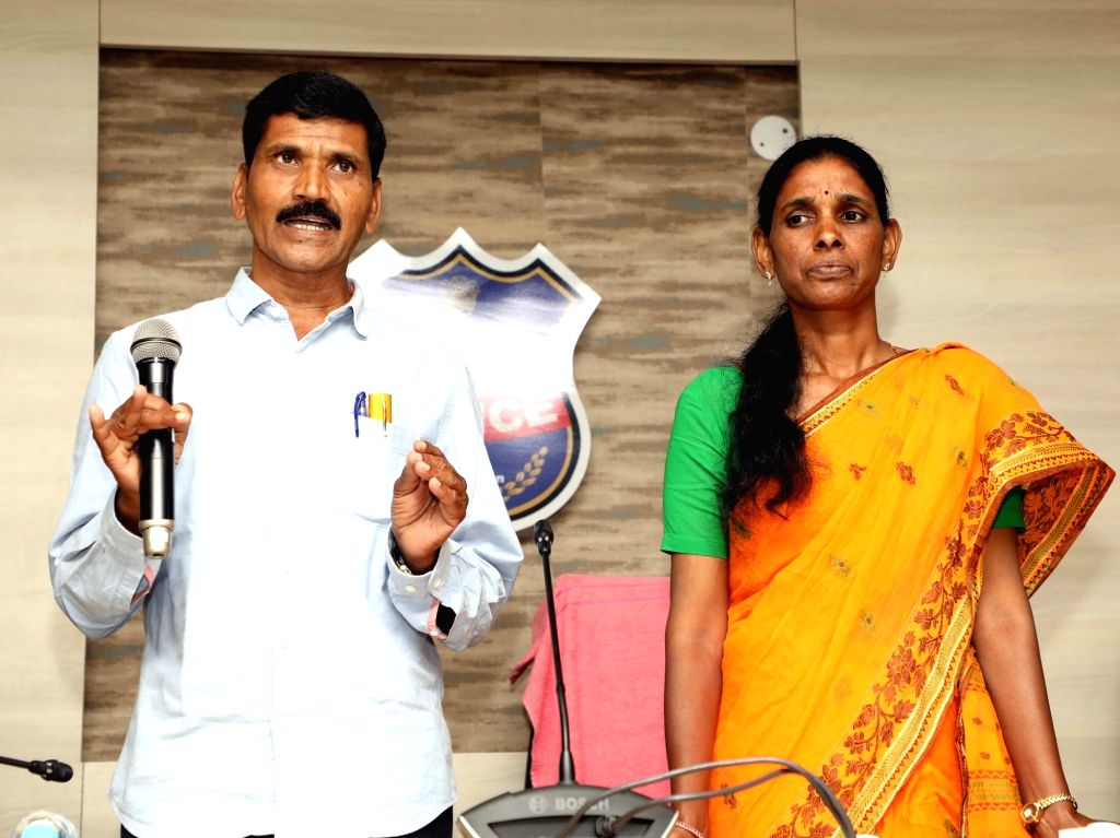 Top Maoist leader Buriyar Sathwaji and his wife Vydugula Aruna, also a Maoist, surrender before Telangana Police in Hyderabad on Feb 13, 2019.