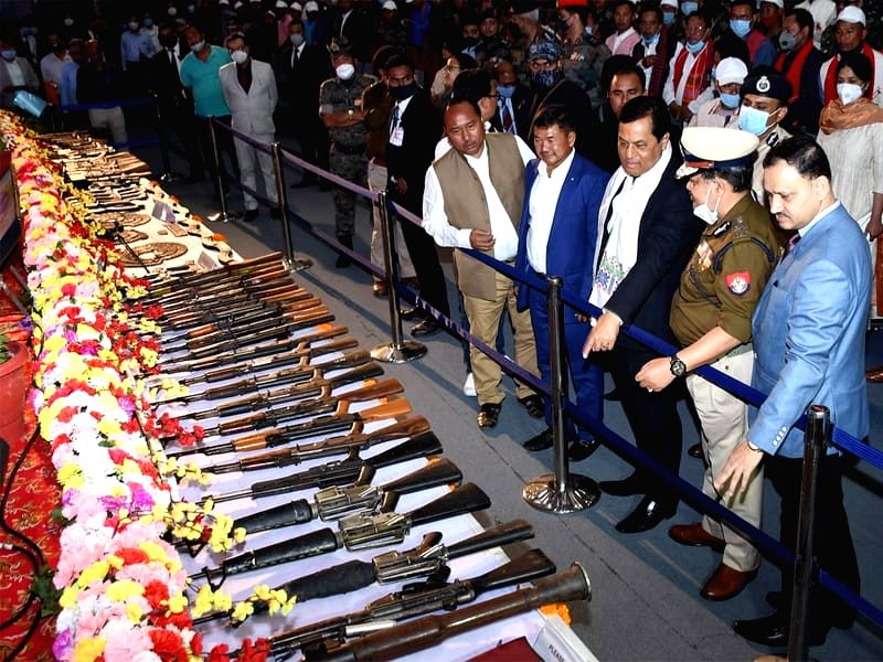 Top terrorist, 1,039 others lay down arms in Assam.