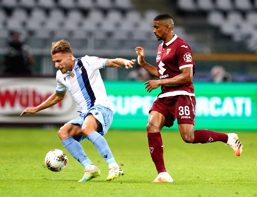 Torino's Bremer (R) vies with Lazio's Ciro Immobile during a Serie A football match between Torino and Lazio in Turin, Italy, June 30, 2020.