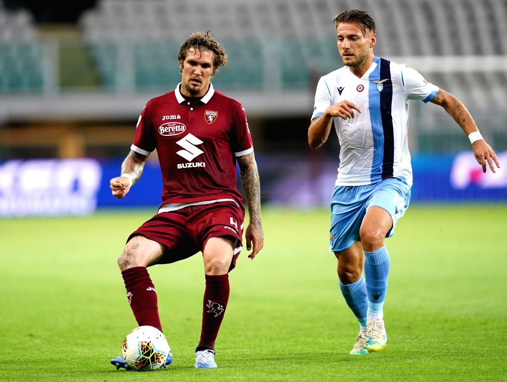 Torino's Lyanco (L) vies with Lazio's Ciro Immobile during a Serie A football match between Torino and Lazio in Turin, Italy, June 30, 2020.
