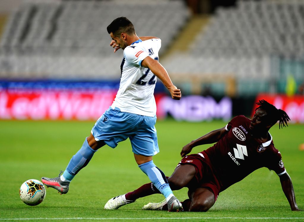 Torino's Soualiho Meite (R) vies with Lazio's Jony during a Serie A football match between Torino and Lazio in Turin, Italy, June 30, 2020.