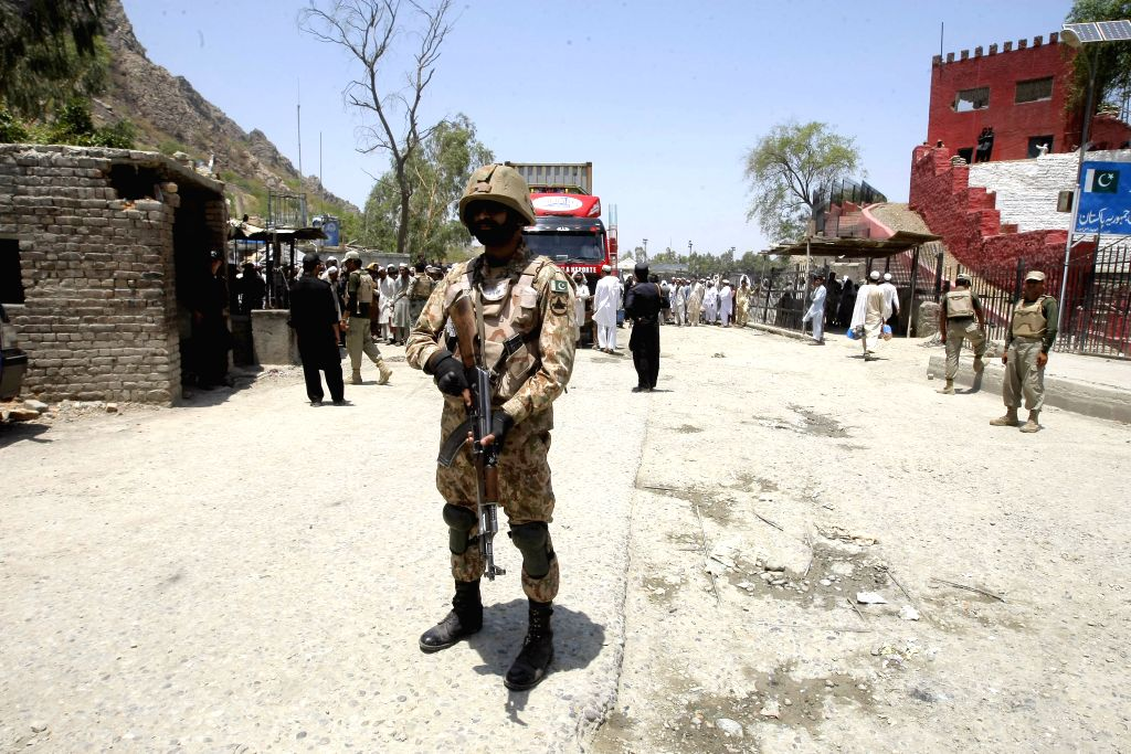 TORKHAM, June 19, 2016 - A Pakistani soldier stands at the border crossing in northwest Pakistan's Torkham on June 18, 2016. Pakistan on Saturday opened its busiest border crossing with Afghanistan ...