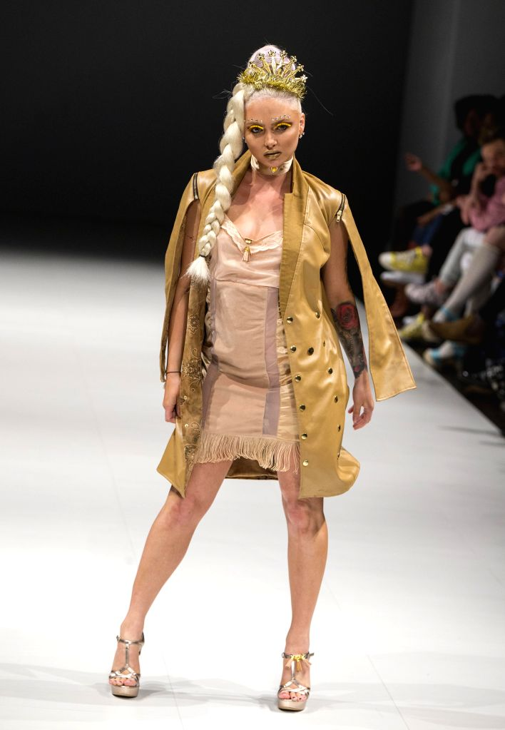 TORONTO, April 20, 2017 - A model presents a creation by Nique during the 2017 Fashion Art Toronto event in Toronto, Canada, April 19, 2017. Kicked off on Tuesday, the five-day event is expected to ...