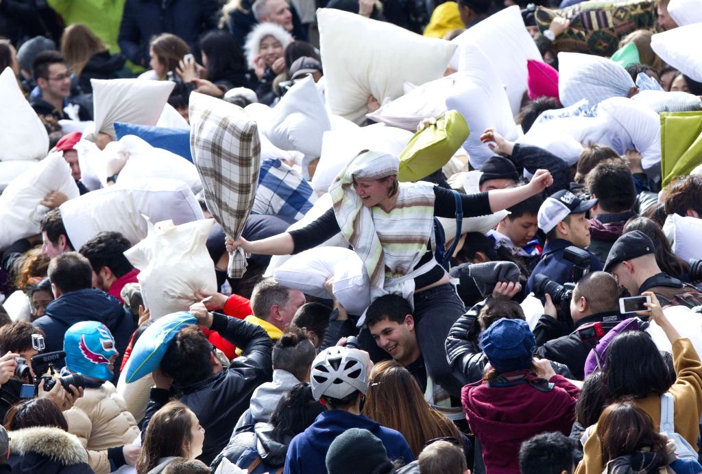 People take part in the 2015 pillow fight event at the Nathan Phillips Square in Toronto, Canada, April 4, 2015. The 2015 International Pillow Fight Day event ran ...