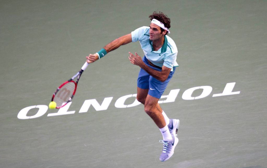 Roger Federer of Switzerland serves during the semifinal of men's singles against Feliciano Lopez of Spain at the 2014 Rogers Cup in Toronto, Canada, Aug. 9, 2014. .