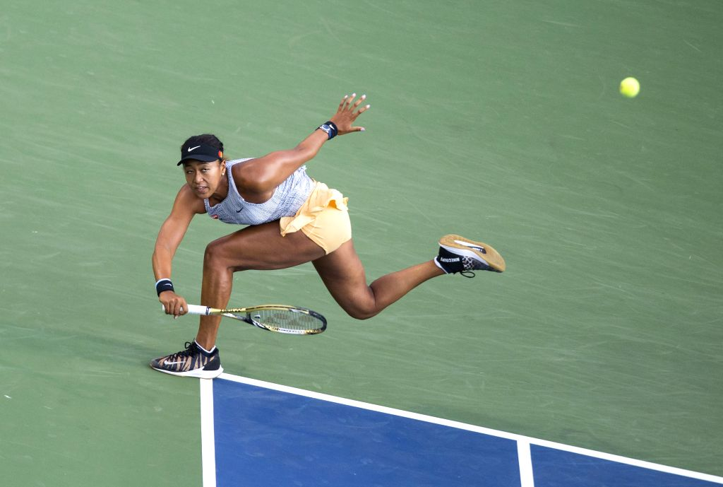 TORONTO, Aug. 10, 2019 - Naomi Osaka of Japan returns the ball during the quarterfinals of women's singles match between Serena Williams of the United States and Naomi Osaka of Japan at the 2019 ...