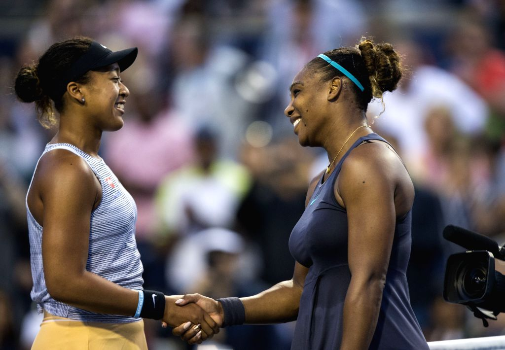 TORONTO, Aug. 10, 2019 - Serena Williams(R) of the United States shakes hands with Naomi Osaka of Japan after the quarterfinals of women's singles match between Serena Williams of the United States ...