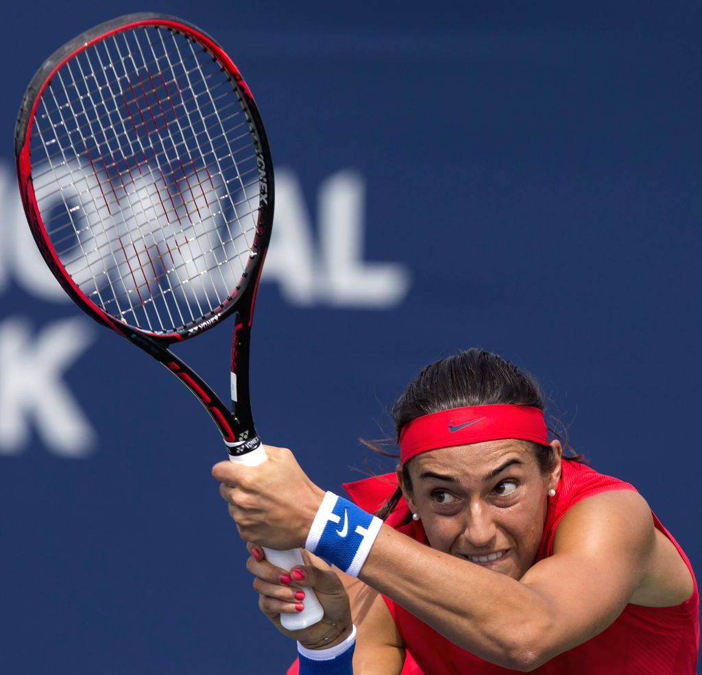 TORONTO, Aug. 11, 2017 - Caroline Garcia of France returns the ball against Catherine Bellis of the United States during their third round of women's singles match at the 2017 Rogers Cup in Toronto, ...