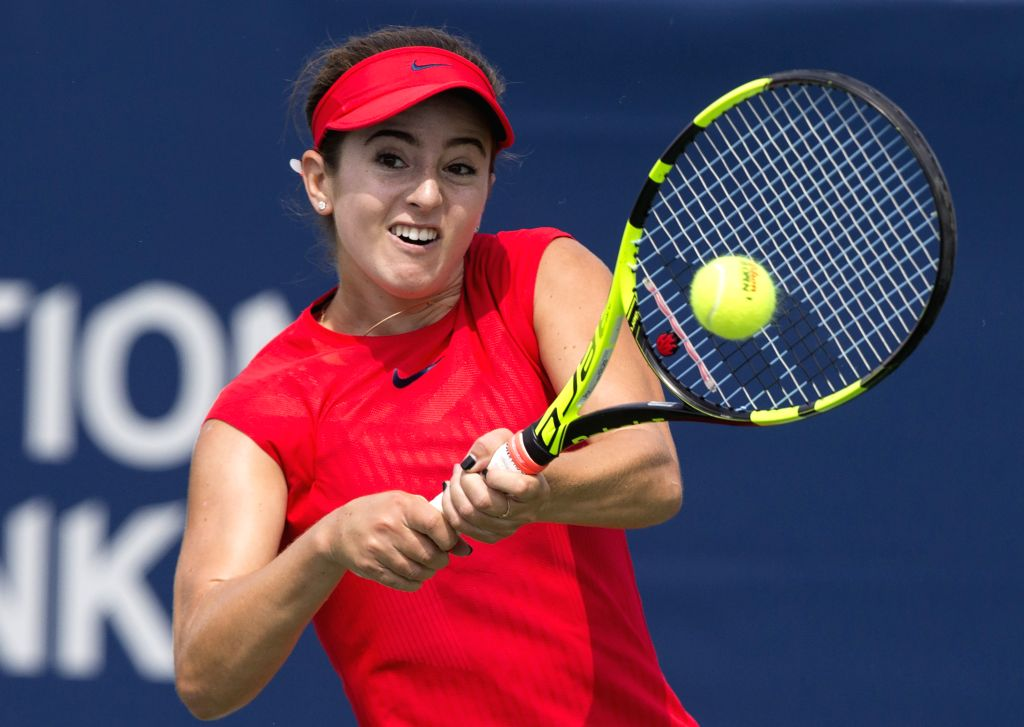TORONTO, Aug. 11, 2017 - Catherine Bellis of the United States returns the ball against Caroline Garcia of France during their third round of women's singles match at the 2017 Rogers Cup in Toronto, ...
