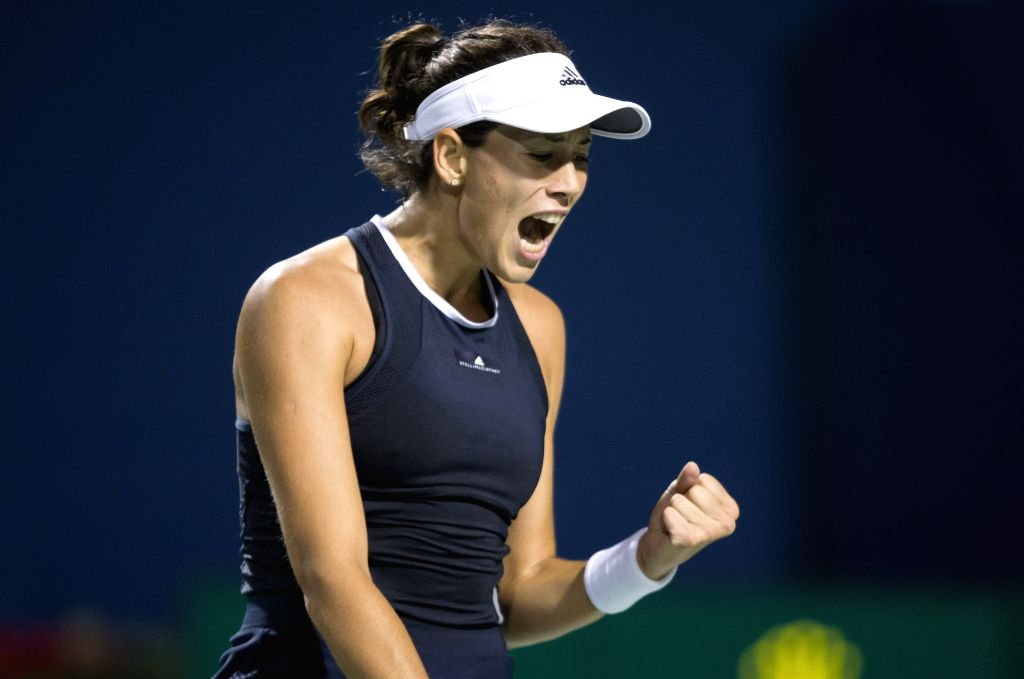 TORONTO, Aug. 11, 2017 - Garbine Muguruza of Spain celebrates scoring during the third round of women's singles match against Ashleigh Barty of Australia at the 2017 Rogers Cup in Toronto, Canada, ...