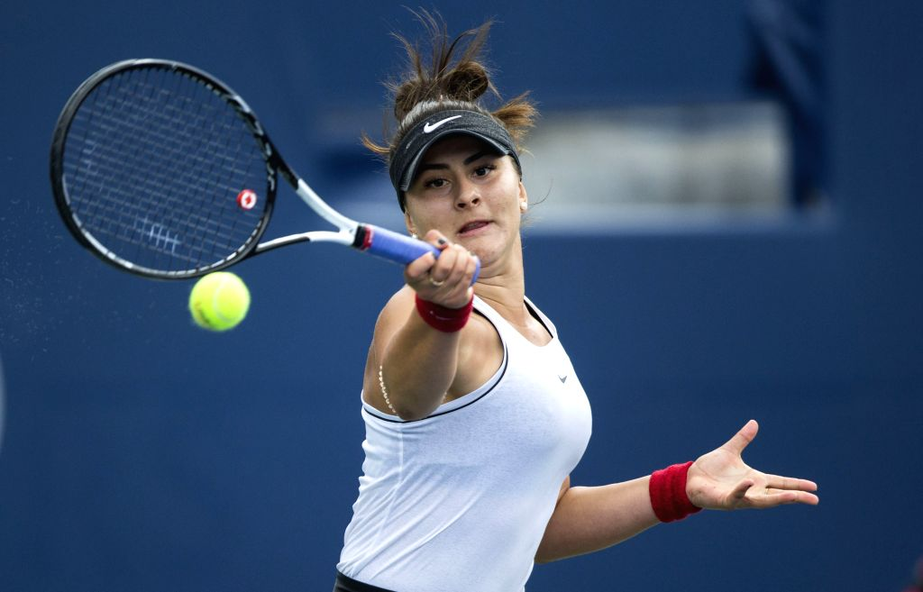 TORONTO, Aug. 11, 2019 - Bianca Andreescu of Canada returns the ball during the women's singles semifinal match between Bianca Andreescu of Canada and Sofia Kenin of the United States at the 2019 ...