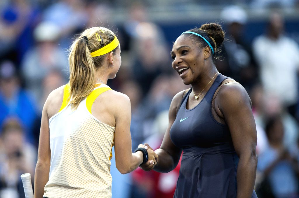 TORONTO, Aug. 11, 2019 - Serena Williams (R) of the United States shakes hands with Marie Bouzkova of the Czech Republic after their women's singles semifinal match at the 2019 Rogers Cup in Toronto, ...