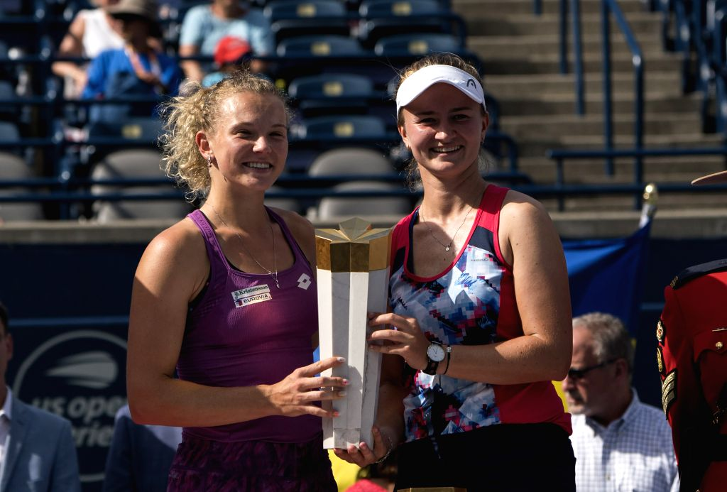 TORONTO, Aug. 12, 2019 - Barbora Krejcikova and Katerina Siniakova (L) of the Czech Republic pose for photos with their trophy during the awarding ceremony after the women's doubles final agaisnt ...