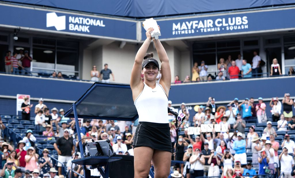 TORONTO, Aug. 12, 2019 - Bianca Andreescu of Canada celebrates victory with trophy during the awarding ceremony of the women's singles event at the 2019 Rogers Cup in Toronto, Canada, Aug. 11, 2019. ...