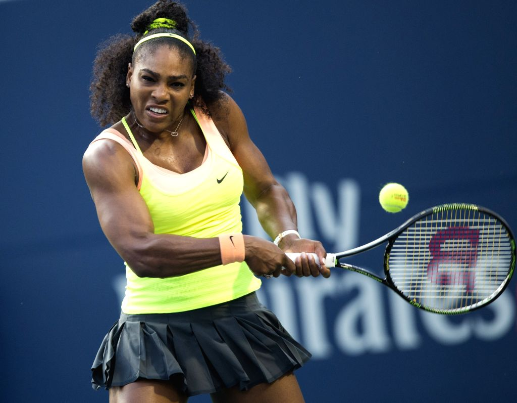 Serena Williams of the United States returns the ball to Roberta Vinci of Italy during the quarterfinal match of women's singles at the 2015 Rogers Cup in Toronto, ...