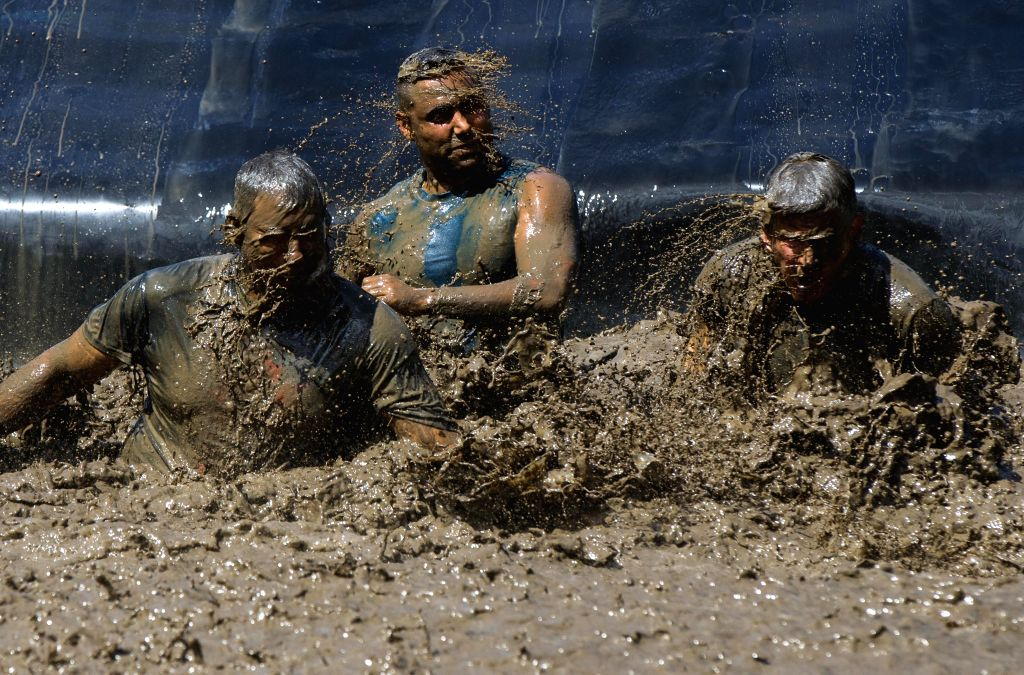TORONTO, Aug. 25, 2019 - Participants take part in the 2019 Mud Hero Toronto North event at Albion Hills Conservation Area in Toronto, Canada, Aug. 24, 2019.