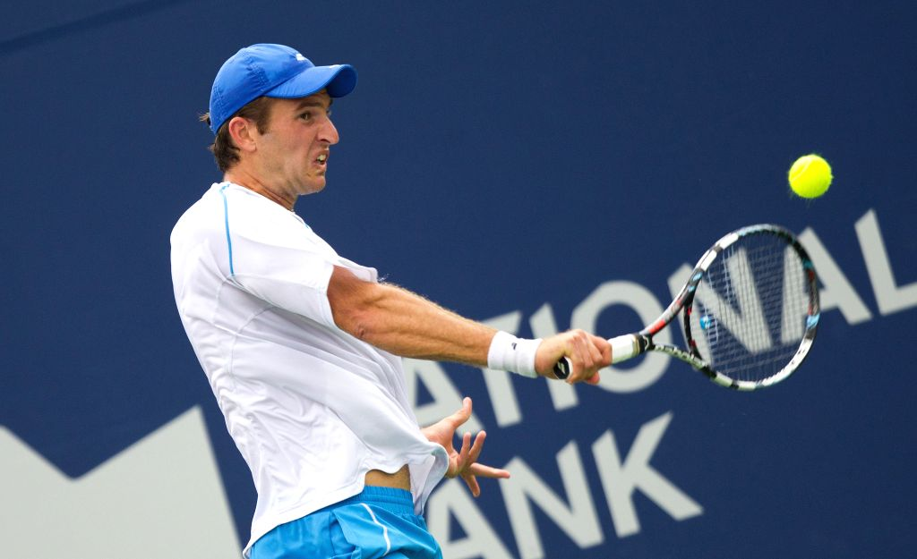 Fabrice Martin of France returns the ball during the first round of men's singles qualifying match against Benjamin Becker of Germany at the 2014 Rogers Cup in ...