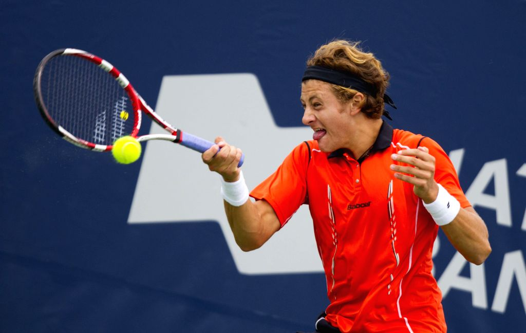 Brayden Schnur of Canada returns the ball during the first round of men's singles against Andreas Seppi of Italy at the 2014 Rogers Cup in Toronto, Canada, Aug. 5, ...