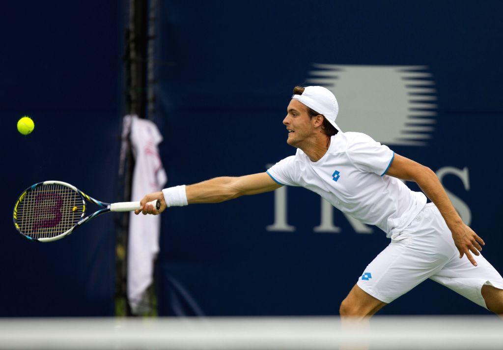 Joao Sousa of Portugal returns the ball during the first round of men's singles against Ernests Gulbis of Latvia at the 2014 Rogers Cup in Toronto, Canada, Aug. 5, ...
