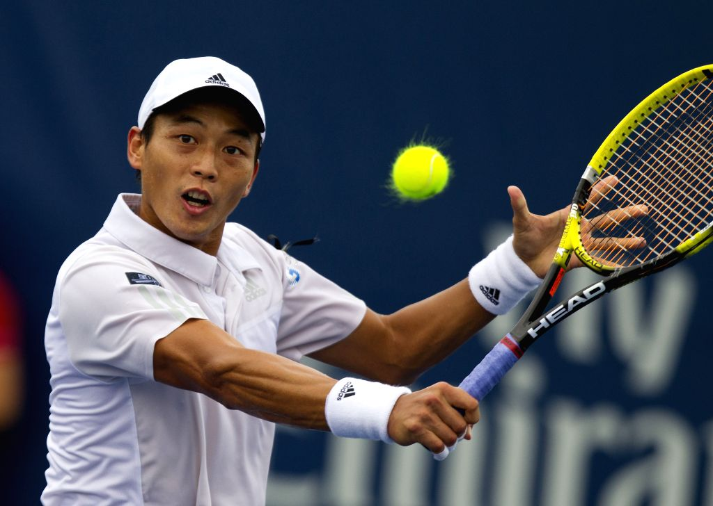 Yen-Hsun Lu of Chinese Taipei returns the ball during the first round of men's singles against Marcel Granollers of Spain at the 2014 Rogers Cup in Toronto, Canada, ..