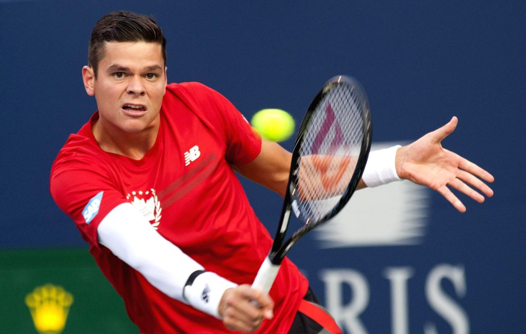 Milos Raonic of Canada returns the ball during the second round of men's singles against Jack Sock of the United States at the 2014 Rogers Cup in Toronto, Canada, ...