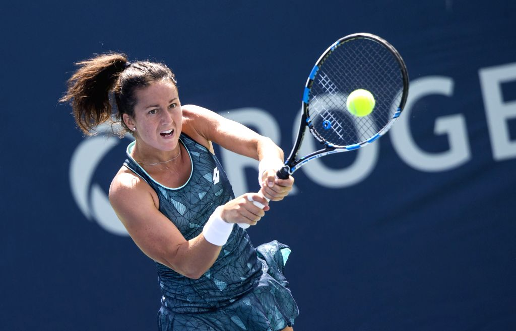 TORONTO, Aug. 7, 2017 - Lara Arruabarrena of Spain returns the ball to Risa Ozaki of Japan during the second round of women's singles qualifying match at the 2017 Rogers Cup in Toronto, Canada, Aug. ...