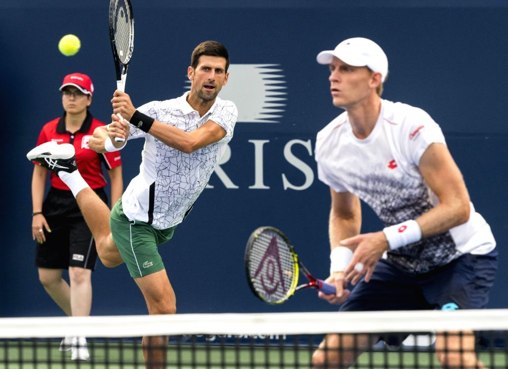 TORONTO, Aug. 7, 2018 - Novak Djokovic (C) of Serbia and Kevin Anderson of South Africa compete during the frist round of men's doubles match against Denis Shapovalov/Felix Auger-Aliassime of Canada ...