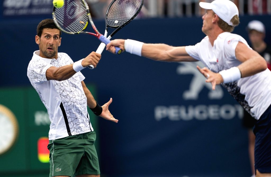 TORONTO, Aug. 7, 2018 - Novak Djokovic (L) of Serbia and Kevin Anderson of South Africa compete during the frist round of men's doubles match against Denis Shapovalov/Felix Auger-Aliassime of Canada ...