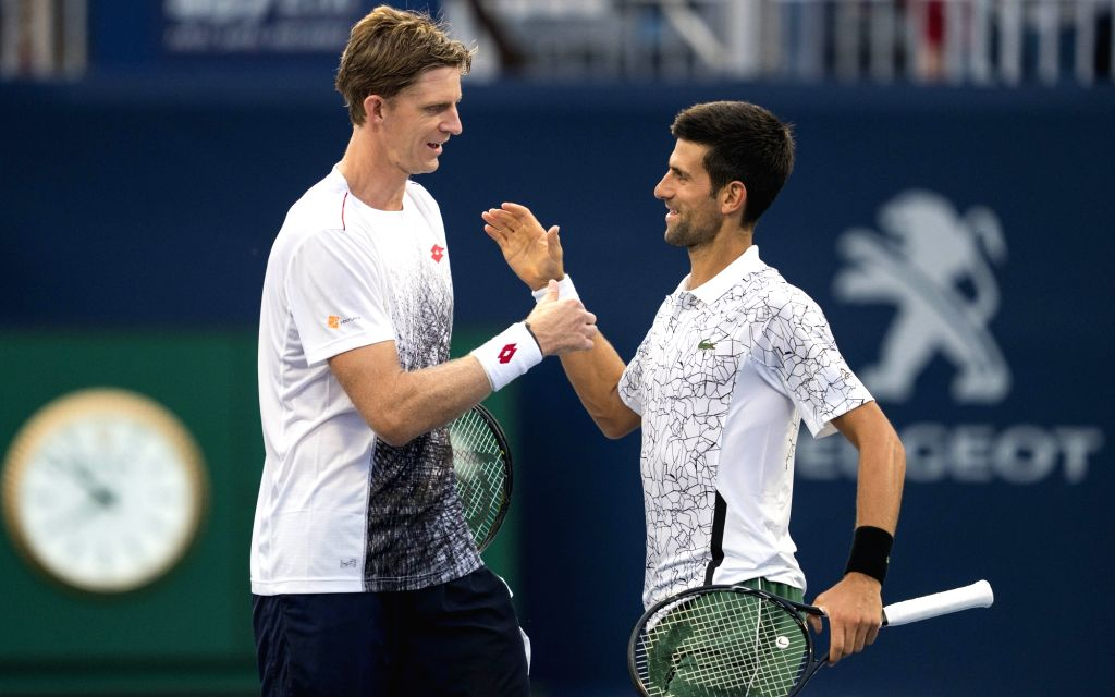 TORONTO, Aug. 7, 2018 - Novak Djokovic (R) of Serbia and Kevin Anderson of South Africa celebrate victory after the frist round of men's doubles match against Denis Shapovalov/Felix Auger-Aliassime ...