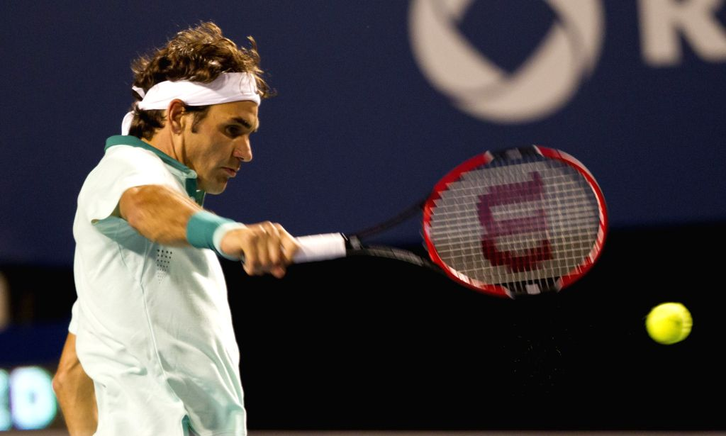 Roger Federer of Switzerland returns the ball during the third round of men's singles against Marin Cilic of Croatia at the 2014 Rogers Cup in Toronto, Canada, Aug. ..