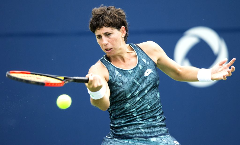 TORONTO, Aug. 8, 2017 - Carla Suarez Navarro of Spain returns the ball to Petra Kvitova of the Czech Republic during their first round of women's singles match at the 2017 Rogers Cup in Toronto, ...