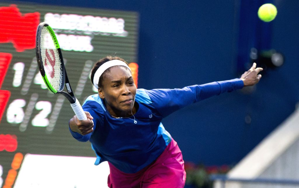 TORONTO, Aug. 8, 2017 - Venus Williams of the United States returns the ball against Irina-Camelia Begu of Romania during their first round of women's singles match at the 2017 Rogers Cup in Toronto, ...