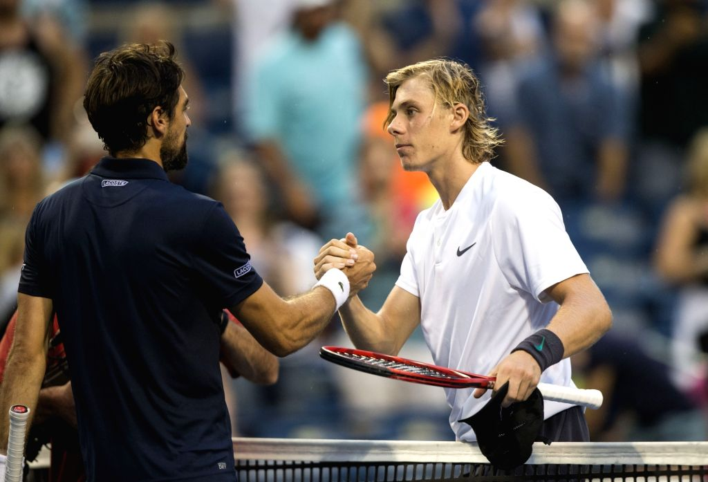 TORONTO, Aug. 8, 2018 - Denis Shapovalov (R) of Canada shakes hands with Jeremy Chardy of France after their first round of men's singles match at the 2018 Rogers Cup in Toronto, Canada, Aug. 7, ...